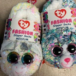 Two pairs Meduim slipper socks.